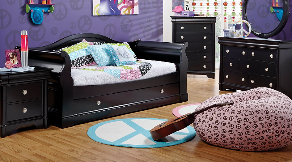 Black Daybed Set Featuring Splashes of Purple & Pink Decor
