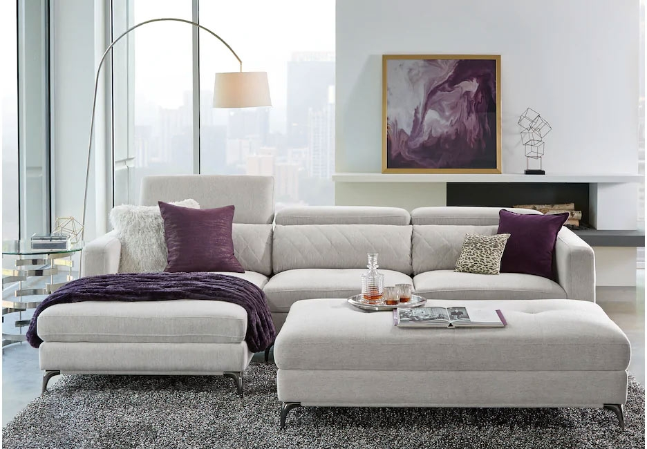 Gray Upholstered Sectional with Matching Storage Ottoman with Purple Decor