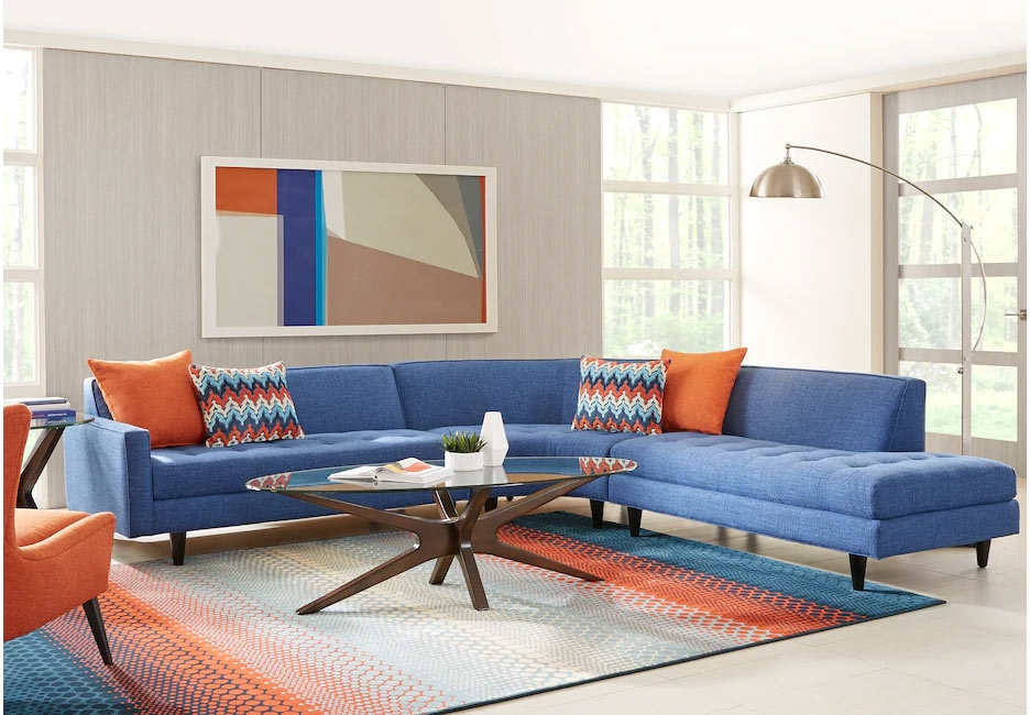 Modern Blue Sectional Sofa with Orange Decorative Accents & Matching Chair