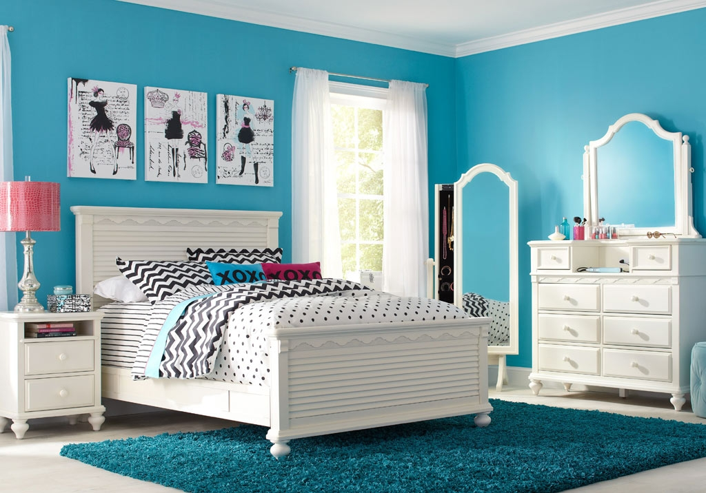 White Bedroom Set Contrasted by Ice Blue with Splashes of Patterns