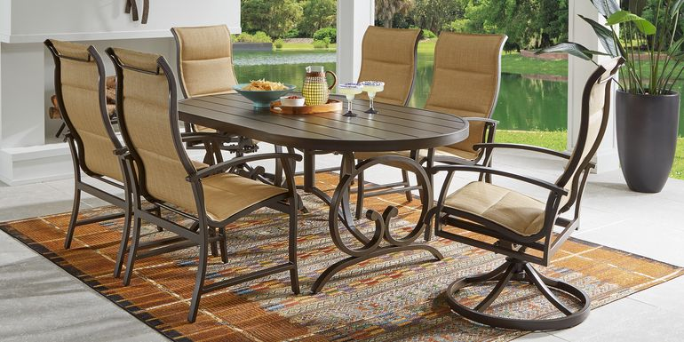 Bermuda Breeze Aged Bronze 7 Pc Outdoor 74 in. Oval Dining Set with Sling Chairs