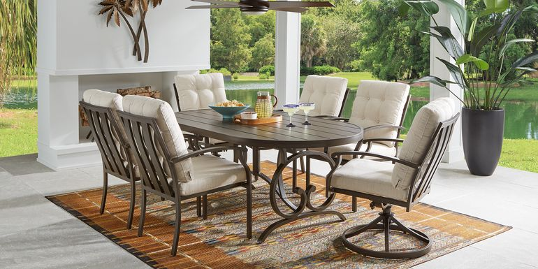 Bermuda Breeze Aged Bronze 7 Pc Outdoor 74 in. Oval Dining Set with Parchment Cushions